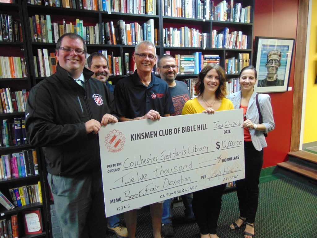 Kinsmen Book Fair Donation Supports Library Foundation